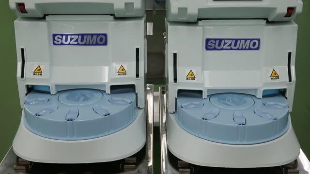 Suzumo Machinery Co SSNJLX compact sushi making machines sit at the company's factory in Kawashima Saitama Japan on Monday Aug 7 2017