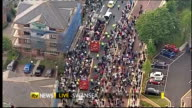 Swansea City promoted to Premier League AIR VIEW / AERIAL Swansea City team waving to crowds from opentop bus during parade