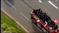 victory parade WALES Swansea EXT Various AIR VIEWs / AERIALs Swansea City team opentop bus parade through city centre to celebrate promotion to...