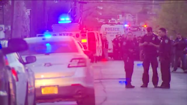 NYPD swarm the crime scene of an officer shooting Demetrius Blackwell is accused of firing at Moore and his partner as they sat in plainclothes in an...