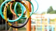 swaying gymnastic rings for kids in playground