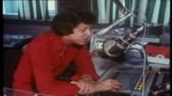 Swedish DJ Ulf Elfving in radio studio plays ABBA record 'Dancing Queen' / announcing into microphone