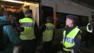 Swedish police carry out checks on trains from Denmark after the government reinstated border controls to deal with an unprecedented influx of...