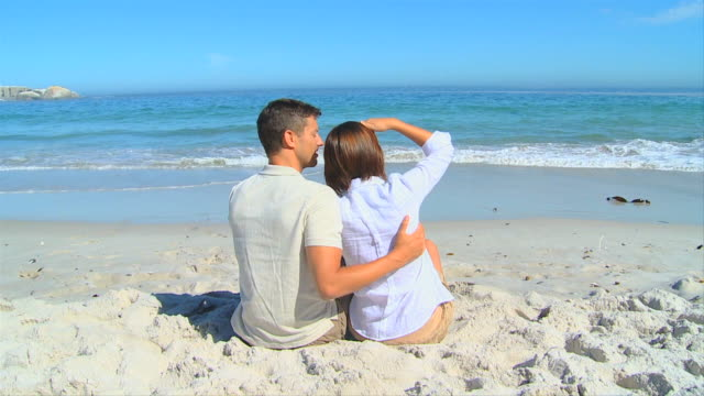 Sweet couple relaxing looking far away / Cape Town, Western Cape, South Africa