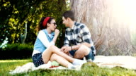 Sweet couple talking while they have picnic