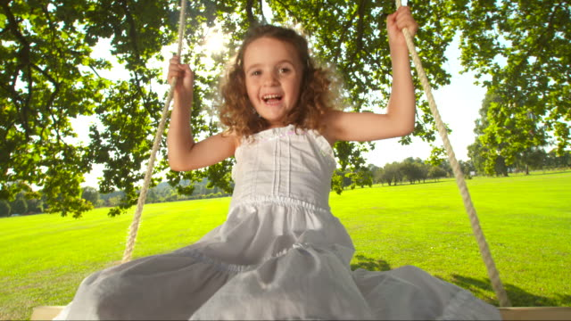 HD SLOW MOTION: Sweet Little Girl Swinging