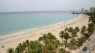 Swimmers and sunbathers lounge on the beach in the Isla Verde neighborhood of San Juan Puerto Rico on May 30th 2015 Shots Shots look down at the...