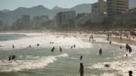 Swimmers and surfers gather at Arpoador near Ipanema beach located outside Guanabara Bay on August 3 2015 in Rio de Janeiro Brazil The Rio government...