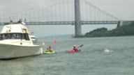 Swimmers from around the world challenge themselves in the annual 30 mile circuit of Manhattan Island Solo swimmers passes George Washington Bridge...