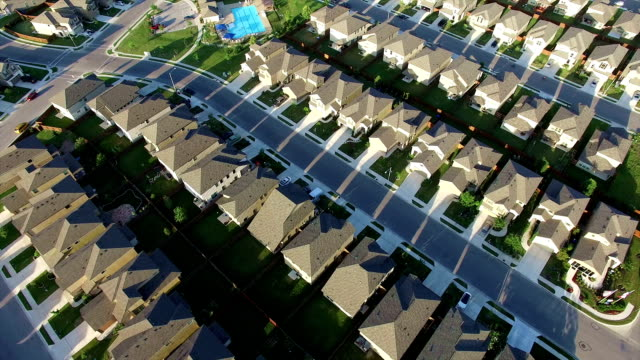 Swimming Pool at center of New Suburb Outside of Austin Texas near Round Rock aerial house after house after house
