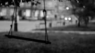 Swinging swing, passing car in background, black and white