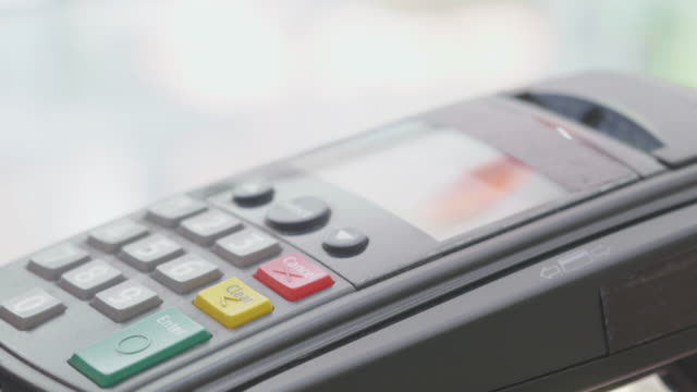 Swiping A Credit Card,Close-up