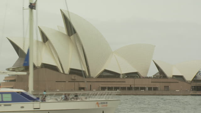 Sydney Opera House, yacht passing, Australia