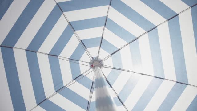 Symbols of summer: spinning beach umbrella
