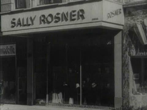 Synagogue Jewish stores rich Jews walking down a street