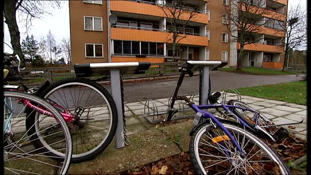 Syrian asylum seekers in Stockholm Apartment blocks / satellite dishes / bicycles / man on crutches / apartment block / balconies / PAN housing...