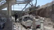 Syrian civil defence members search for survivors in the rubble of destroyed buildings following the ongoing airstrikes of Syrian regime warplanes on...