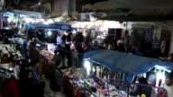 Syrian Muslims shop ahead of Eid alFitr during the holy month of Ramadan in Idlib Syria on June 24 2017 Syrian Ibrahim Ceyco Arif Abu Hamza Rami al...