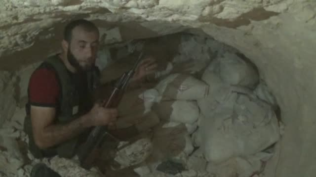 Syrian opponents pass through a tunnel before they clash with Assad regime forces in Aleppo Syria on August 31 2015 Opponents attacked regime forces...