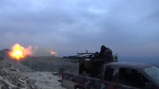 Syrian opposition members launch attacks during an operation against Assad regime forces near Latakia Syria on March 12 2015 It is reported that...