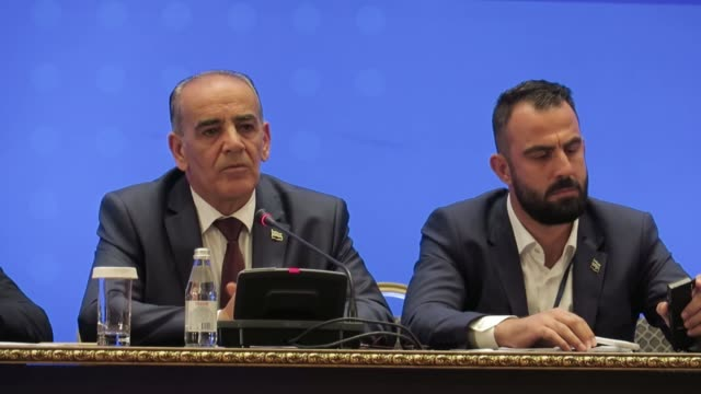 Syrian opposition spokesman Yahya AlAridi and Syrian opposition group member Ayman alAsimi speak to reporters following the sixth round of Syrian...