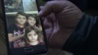 Syrian orthopedic surgeon Mahmood Sayeh shows pictures of his wife and his 7 children whom he lost in an air raid carried out by Sryian regime forces...