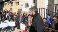 Syrian people take part in a demonstration after friday prayer as they demand from all opposition groups to come together in same roof at the Zemelka...