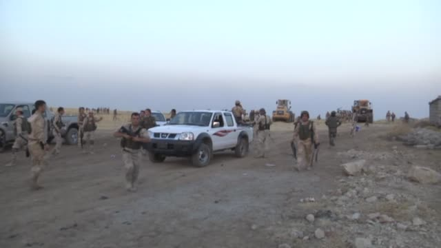 Syrian People's Protection Units members fight against army groups led by Islamic State of Iraq and the Levant to capture Mahmudiye village with 100...