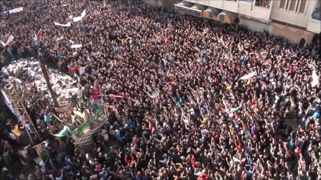 Syrian police used tear gas to disperse some 70000 people who took to the streets of Homs on Tuesday as Arab observers visited there a day after...