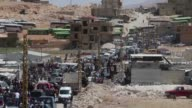 Syrian refugees are seen as they leave Lebanon after the ceasefire announced between Hezbollah and Ahrar alSham in Arsal town of Baalbek Lebanon on...