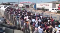 Syrian refugees cross the Oncupinar border crossing gate into Syria to spend the last days of the Muslim holy fasting month of Ramadan and Eid AlFitr...