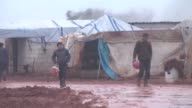 Syrian refugees fled their homes due to the attacks of Assad regime forces try to hold on life under harsh living conditions worsened by heavy rains...