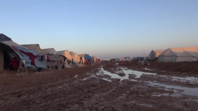 Syrian refugees fled their homes due to the attacks of Assad's forces suffer from cold weather and hard living conditions in the tent camps of Azez...