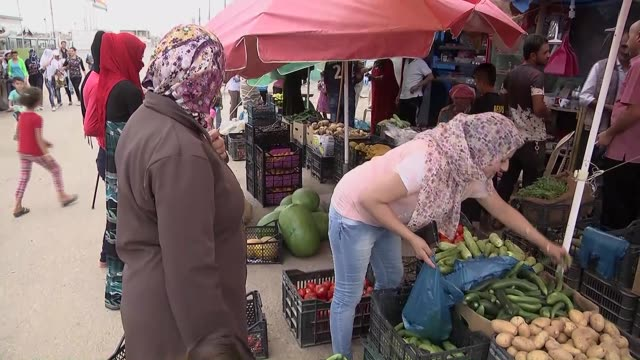 Syrian refugees in Kevirgosk refugee camp shop for Ramadan in spite of hard living conditions in Arbil Iraq on 18 June 2015