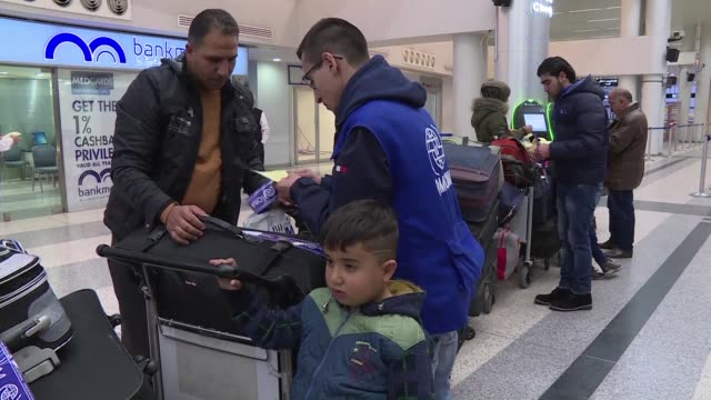 Syrian refugees in Lebanon are greeted by the French ambassador at Beirut airport as they prepare to embark on a one way journey to France where they...