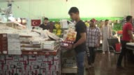 Syrian refugees make preparations for the upcoming Eid alFitr the threeday celebration marking the end of the holy fasting month of Ramadan in...