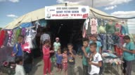 Syrian refugees make preparations for the upcoming Eid alFitr the threeday celebration marking the end of the holy fasting month of Ramadan at the...