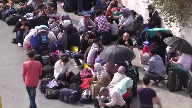 Syrian refugees wait at Istanbul bus terminal to go to Germany through Greece in Istanbul Turkey on September 15 2015 Footage by Umut Ozgan / Anadolu...