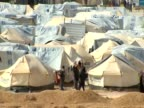 Syrian refugees walk around Zaatari camp Jordan