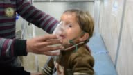 Syrians including children receive treatment at a local hospital following an alleged chlorine gas containing barrel bomb attack by Assad regime...