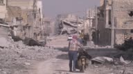 Syrians return alBab town after Turkeybacked Free Syrian Army took control of the town center from Daesh terrorists as part of the ongoing Operation...