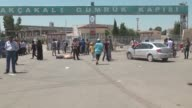 Syrians return to the Syrian town of Tal Abyad in Turkey's Sanliurfa province through the Akcakale Border gate on June 22 2015 after Kurdish fighters...