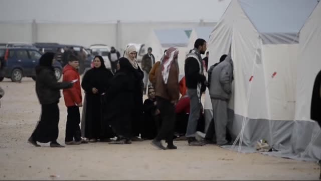 Syrians who flee the attacks of Syrian and Russian air forces shelter at tents set up by the Turkish NGO IHH Humanitarian Relief Foundation at the...