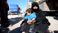 Syrians who have fled the attacks of Syrian and Russian air forces take shelter near the Bab alSalameh border crossing on TurkishSyrian border near...