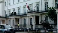 Syria's senior diplomat in London quits over crackdown ENGLAND London Exterior of Syrian Embassy with flag flying outside Barred windows Flag flying...