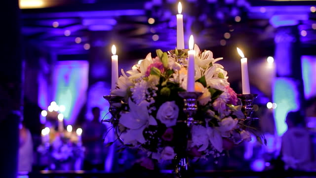 Table decoration with candles and flowers