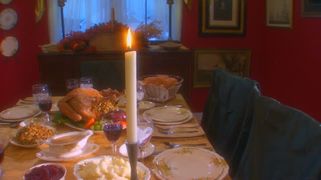 Table set for Thanksgiving, crane shot, slow motion, close up