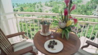 CU, CS, Table with champagne and flowers on balcony overlooking ocean, Maui, Hawaii, USA