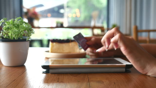 Tablet purchase with credit card in coffee shop