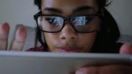 Tablet scrutiny girl.